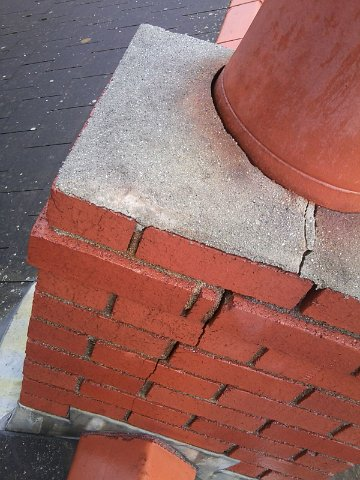 A cracked stack due to damage caused by a blocked chimney.